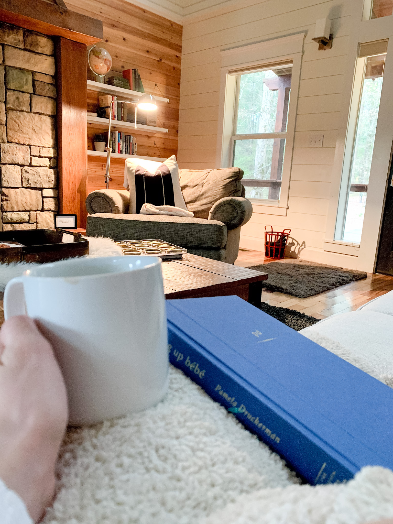 Reading in The Chesapeake at River's Edge Cottages in Watson, Oklahoma